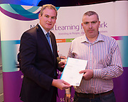 Sean Kyne TD Minister of State for Community Affairs, Natural Resources and Digital Development, presenting certification  in Employer Based Training  to   PJ MurrayQQI level 4 in  Workplace safety and Work Experience. Photo:Andrew Downes, xposure .