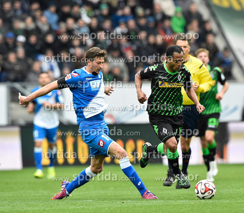 04.04.2015, Rhein Neckar Arena, Sinsheim, GER, 1. FBL, TSG 1899 Hoffenheim vs Borussia Moenchengladbach, 27. Runde, im Bild Raffael Borussia Moenchengladbach am Ball im Zweikampf Aktion gegen Tobias Strobl TSG 1899 Hoffenheim (links) // during the German Bundesliga 27th round match between TSG 1899 Hoffenheim and Borussia Moenchengladbach at the Rhein Neckar Arena in Sinsheim, Germany on 2015/04/04. EXPA Pictures &copy; 2015, PhotoCredit: EXPA/ Eibner-Pressefoto/ WEBER<br /> <br /> *****ATTENTION - OUT of GER*****
