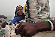 New Delhi, India - <br /> <br /> Garbage Mountain<br /> <br /> Just a few miles from the famous Akshardham temple, where tourists flock to see the structure's sandstone and marble work, the 29-hectare, slum-surrounded Ghazipur landfill in east Delhi seems a world apart. Each day hundreds of mainly migrant workers earn a meager living at the landfill by collecting recyclable material like plastic, metal and even hair to sell. The dump is the last port of call for Delhi's trash, having already been picked through by other waste collectors who collect bags of garbage directly from homes. Delhi is home to three landfills where around 6,000 tons of trash is dumped daily. Studies have shown that living near a landfill increases the risk of cancer, birth defects and asthma.<br /> <br /> Photo shows: BHAGMATI KUMARI has been working at the landfill ever since she lost her husband 14 years ago. She earns 50-70 rupees, which is approximately one dollar, for sifting and sorting garbage for nine hours a day.<br /> ©Chinky Shukla/Exclusivepix Media