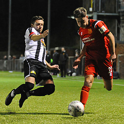 TELFORD COPYRIGHT MIKE SHERIDAN Niall Flint is tackled during the Cymru Premier fixture between Cefn Druids and Newtown AFC at the Rock on Friday, October 11, 2019<br /> <br /> Picture credit: Mike Sheridan/Ultrapress<br /> <br /> MS201920-024
