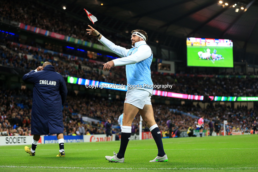 10th October 2015 - Rugby World Cup (Pool A) - England v Uruguay - Tom Wood of England throws a paper aeroplane back into the stands - Photo: Simon Stacpoole / Offside.