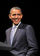 US President Barack Obama smiles as he addresses a Democratic National Committee fundraiser in Austin, Texas 10 May, 2011. The President spoke earlier in the day on immigration reform in El Paso, Texas.