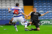 Photo: Leigh Quinnell.<br /> Queens Park Rangers v Cardiff City. Coca Cola Championship. 18/08/2007. Cardiffs Kevin McNaughton enters a strong challenge with QPRs Hogan Ephraim.