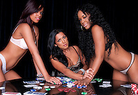 Sexy girls playing poker in lingerie at clubhouse.
