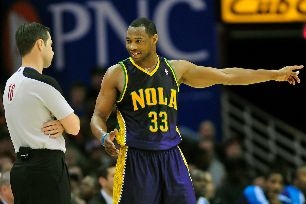 March 6, 2011; Cleveland, OH, USA; New Orleans Hornets shooting guard Willie Green (33) argues a call with referee David Guthrie (16) during the fourth quarter against the Cleveland Cavaliers at Quicken Loans Arena. The Hornets beat the Cavaliers 96-81. Mandatory Credit: Jason Miller-US PRESSWIRE
