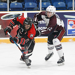 "TRENTON, ON  - MAY 2,  2017: Canadian Junior Hockey League, Central Canadian Jr. ""A"" Championship. The Dudley Hewitt Cup. Game 1 between Dryden GM Ice Dogs and the Georgetown Raiders. Jonathan Hampton #71 of the Georgetown Raiders shoots the puck and is checked by  Cory Dennis #12 of the Dryden GM Ice Dogs  during the first period.  <br /> (Photo by Tim Bates / OJHL Images)"