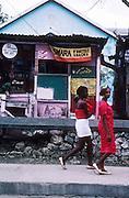 12 FEBRUARY 1986, OCHO RIOS, JAMAICA: Jamaican women walk past a streetside snack shop Ocho Rios, Jamaica, Feb. 1987..PHOTO BY JACK KURTZ