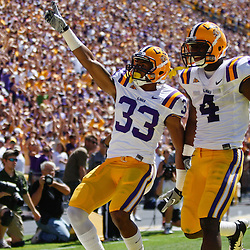 October 1, 2011; Baton Rouge, LA, USA;  LSU Tigers wide receiver Odell Beckham (33) celebrates with teammate running back Alfred Blue (4) following a touchdown during the second quarter against the Kentucky Wildcats at Tiger Stadium.  Mandatory Credit: Derick E. Hingle-US PRESSWIRE / © Derick E. Hingle 2011