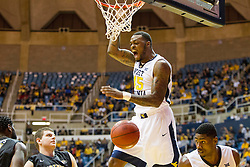 Nov 13, 2015; Morgantown, WV, USA; West Virginia Mountaineers forward Elijah Macon dunks the ball during the first half against the Northern Kentucky Norse at WVU Coliseum. Mandatory Credit: Ben Queen-USA TODAY Sports