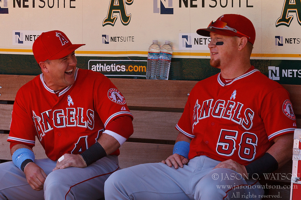 OAKLAND, CA - JUNE 21:  Daniel Robertson #44 of the Los Angeles Angels of Anaheim and Kole Calhoun #56 sit in the dugout before the game against the Oakland Athletics at O.co Coliseum on June 21, 2015 in Oakland, California. The Oakland Athletics defeated the Los Angeles Angels of Anaheim 3-2. (Photo by Jason O. Watson/Getty Images) *** Local Caption *** Daniel Robertson; Kole Calhoun