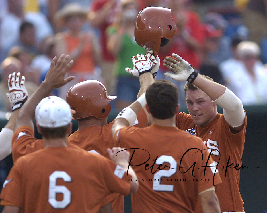 Texas Longhorn Will Crouch (far right) celebrates with his teammates, after hitting a solo homerun in the top of the third inning against Florida.  Texas defeated Florida 4-2 in game one of the Championship Series of the College World Series at Rosenblatt Stadium in Omaha, Nebraska on June 25, 2005.