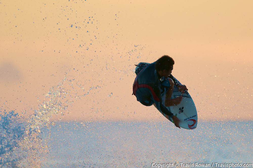 "Professional Balinese surfer, Made ""Garut"" Widiarta launches into the air on Bali's Kuta beach."
