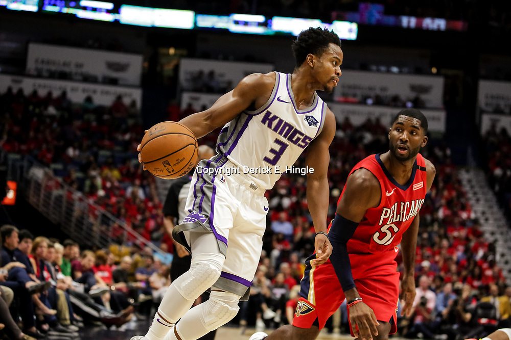 Oct 19, 2018; New Orleans, LA, USA; Sacramento Kings guard Yogi Ferrell (3) drives past New Orleans Pelicans guard E'Twaun Moore (55) during the second quarter at the Smoothie King Center. Mandatory Credit: Derick E. Hingle-USA TODAY Sports