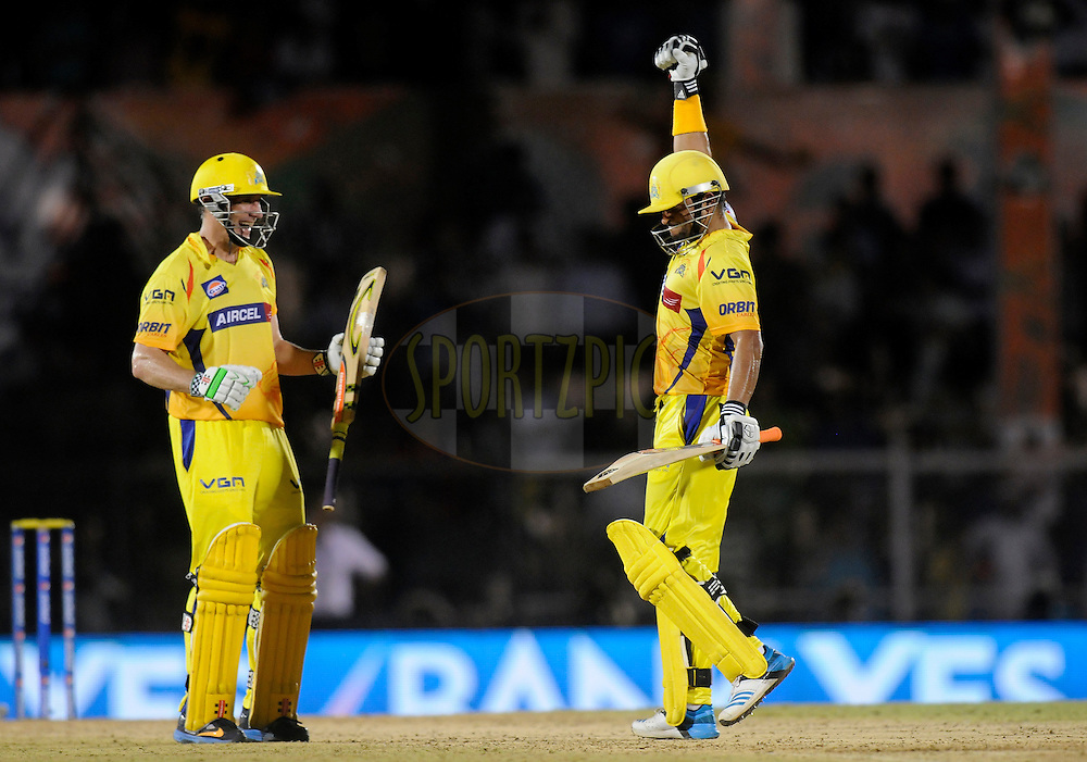 Suresh Raina of The Chennai Superkings celebrates after winning the match as teammate David Hussey of The Chennai Superkings looks on  during the eliminator match of the Pepsi Indian Premier League Season 2014 between the Chennai Superkings and the Mumbai Indians held at the Brabourne Stadium, Mumbai, India on the 28th May  2014<br /> <br /> Photo by Pal PIllai / IPL / SPORTZPICS<br /> <br /> <br /> <br /> Image use subject to terms and conditions which can be found here:  http://sportzpics.photoshelter.com/gallery/Pepsi-IPL-Image-terms-and-conditions/G00004VW1IVJ.gB0/C0000TScjhBM6ikg