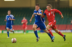CARDIFF, WALES - Saturday, October 11, 2008: Wales' captain Craig Bellamy and Liechtenstein's Fabio D'Elia during the 2010 FIFA World Cup South Africa Qualifying Group 4 match at the Millennium Stadium. (Photo by Gareth Davies/Propaganda)