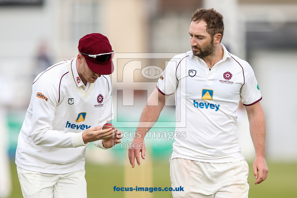 Gareth Wade (left) and Steven Crook of Northamptonshire CCC inspect the ball during day two of the Friendly match at the County Ground, Northampton<br /> Picture by Andy Kearns/Focus Images Ltd 0781 864 4264<br /> 03/04/2017