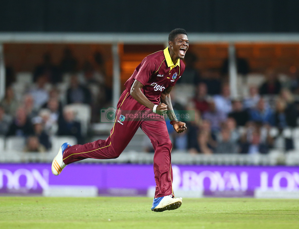 September 27, 2017 - London, England, United Kingdom - Alzarri Joseph of West Indies celebrates the catch of England's Sam Billings  by Chris Gayle of West Indies.during 4th Royal London One Day International Series match between England and West Indies at The Kia Oval, London  on 27 Sept , 2017  (Credit Image: © Kieran Galvin/NurPhoto via ZUMA Press)