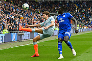 Marcos Alonso (3) of Chelsea hooks the ball up field away from Oumar Niasse (29) of Cardiff City during the Premier League match between Cardiff City and Chelsea at the Cardiff City Stadium, Cardiff, Wales on 31 March 2019.