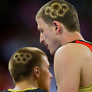 Germany's Steffan Hamann, left, and Patrick Femerling, right, have Olympic ring symbols dyed in their hair in the game against China on August 16, 2008 during the 2008 Summer Olympic Games in Beijing, China. (photo by David Eulitt / MCT)