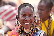 A Maasai woman at a weekly market in Oldorko Maasai village,  several hours from Narok, Kenya. The jewelery worn by the Maasai is symbolic through its colors and patterns.