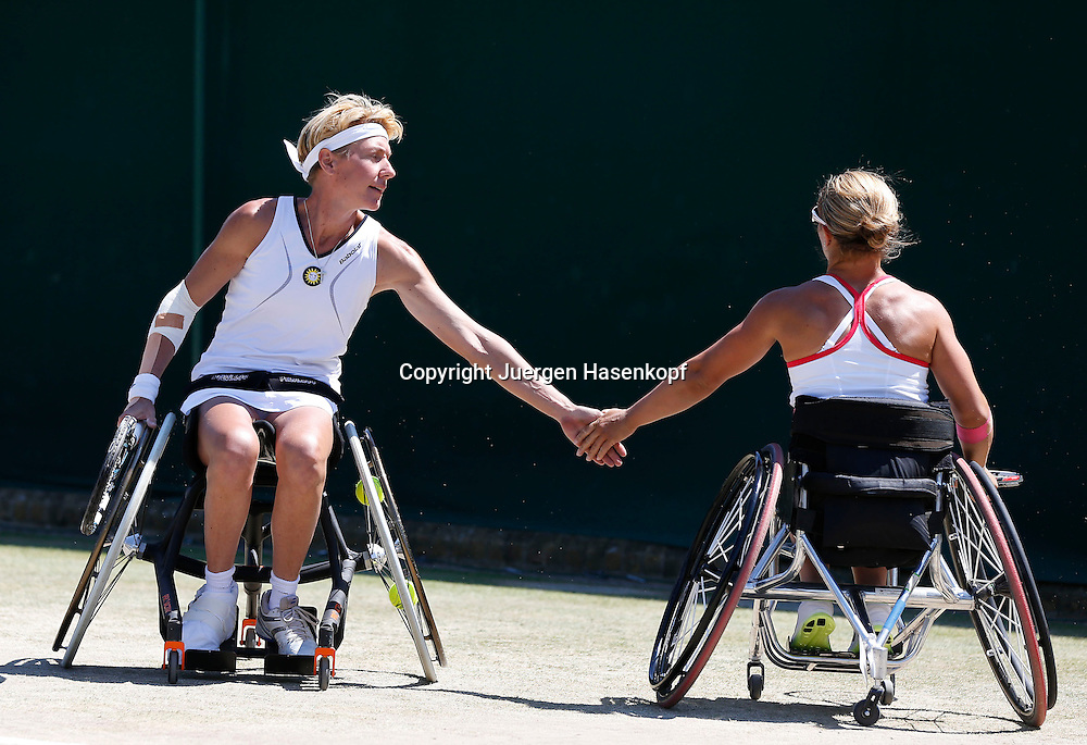 Wimbledon Championships 2014, AELTC,London,<br /> ITF Grand Slam Tennis Tournament,<br /> Rollstuhl Doppel Wettbewerb,<br /> R-L. Lucy Shuker (GBR) klatscht ab mit Sabine Ellerbrock (GER), <br /> Ganzkoerper,Querformat,