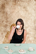 Woman drinking tea alone