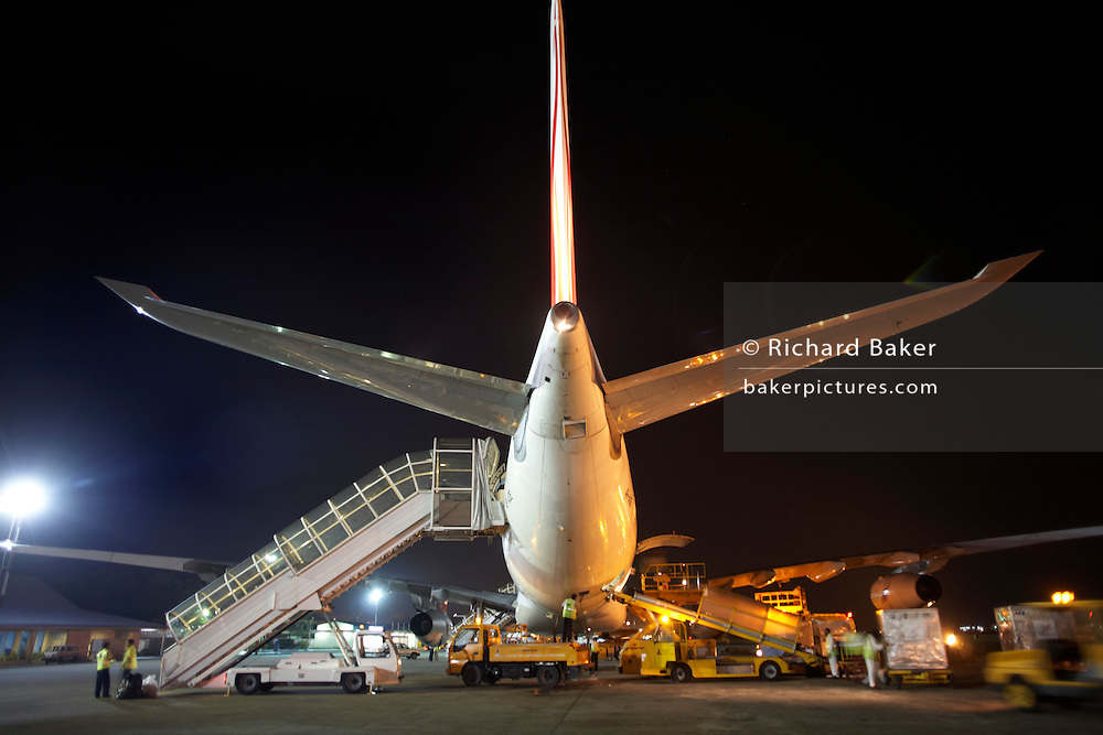On the apron of Malé International Airport, Maldives, a Sri Lankan Airlines A340-300 series Airbus prepares for departure
