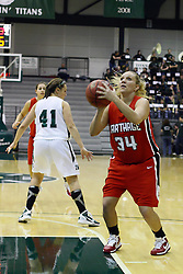 29 January 2011: Kristi Schmidt toes in the paint for an uncontested shot during an NCAA Womens basketball game between the Carthage Reds and the Illinois Wesleyan Titans at Shirk Center in Bloomington Illinois.