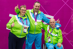 Damjan Pavlin, Francek Gorazd Tirsek and Franc Pinter of Slovenia celebrate after Tirsek won second place during the Men's R4-10m Air Rifle Standing shooting Final during Day 5 of the Summer Paralympic Games London 2012 on September 2, 2012, in Royal Artillery Barracks, London, Great Britain. (Photo by Vid Ponikvar / Sportida.com)