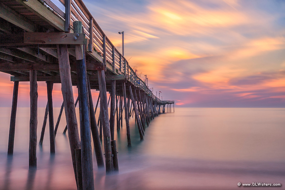 Sunrise at Avalon fishing Pier on the Outer Banks, photographed with a long exposure to accentuate the motion of the clouds and waves.