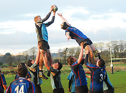 Extendable Eddie,.Westport's Cormac Groden and Rory McCarthy hoist Eddie Dunning up to contest linout ball during the learue final match against Galwegians...Pic Conor McKeown