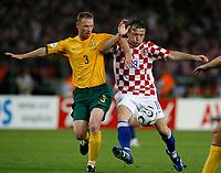 Photo: Glyn Thomas.<br />Croatia v Australia. Group F, FIFA World Cup 2006. 22/06/2006.<br /> Australia's Craig Moore (L) and Croatia's Ivica Olic.