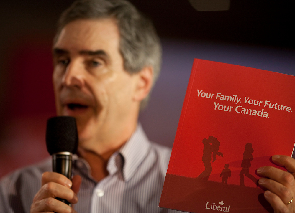 Liberal leader Michael Ignatieff holds up his red book during a large campaign rally at Bingemans Park in Kitchener, Ontario Friday April 29, 2011.<br /> REUTERS/Geoff Robins (CANADA)