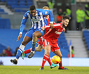 Brighton's Rohan Ince battles with Nottingham Forest's Henri Lansbury during the Sky Bet Championship match between Brighton and Hove Albion and Nottingham Forest at the American Express Community Stadium, Brighton and Hove, England on 7 February 2015. Photo by Phil Duncan.
