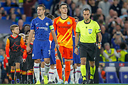 Chelsea defender César Azpilicueta (28), Chelsea goalkeeper Kepa Arrizabalaga (1), Referee Cuneyt Cakir walk the teams on the pitch before kick-off in the Champions League match between Chelsea and Valencia CF at Stamford Bridge, London, England on 17 September 2019.