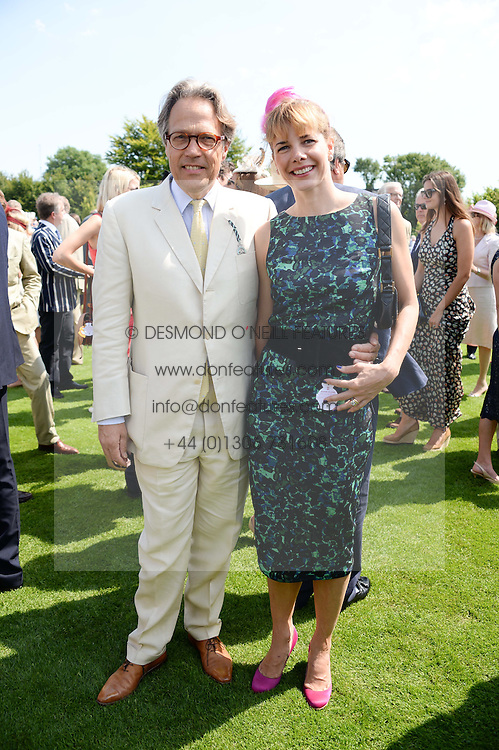 The EARL OF MARCH and DARCEY BUSSELL at the 3rd day of the 2013 Glorious Goodwood racing festival - Ladies day at Goodwood Racecourse, West Sussex on 1st August 2013.