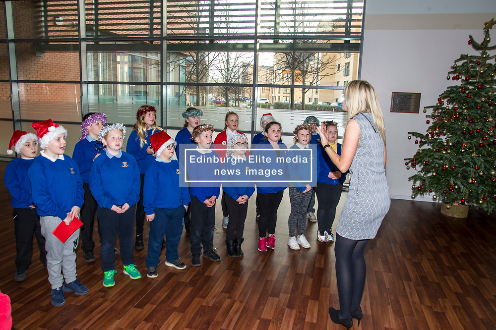 Pictured: John Swinney was greeted by a small choir<br /> Today Deputy First Minister John Swinney visited Niddrie Mill Primary School to announce the publication of Scottish school statistics such as teacher numbers, ratios and class sizes. <br /> <br /> <br /> Ger Harley | EEm 12 December 2017