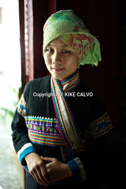 Teen girl wearing a Lahu traditional dress in Laos.
