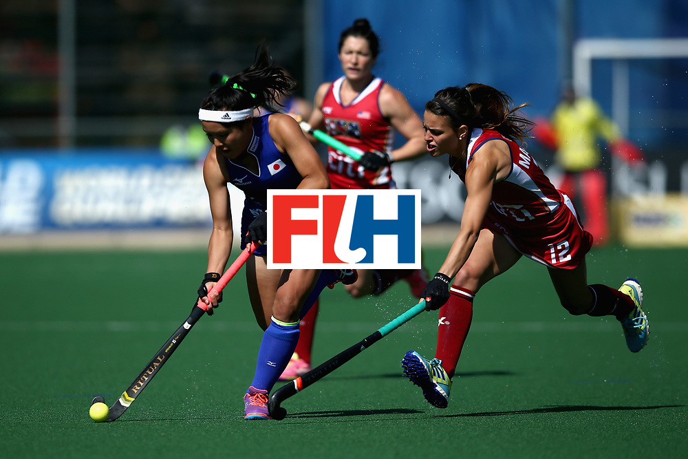 JOHANNESBURG, SOUTH AFRICA - JULY 18:  Motomi Kawamura of Japan attempts to take the ball away from Amanda Magadan of the United States during the Quarter Final match between the United States and Japan during the FIH Hockey World League - Women's Semi Finals on July 18, 2017 in Johannesburg, South Africa.  (Photo by Jan Kruger/Getty Images for FIH)