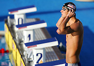 USA's Michael Phelps adjust his cap before the 100m Butterfly semifinal heap at the FINA World Championships in Montreal, Canada, Friday 29 July 2005.