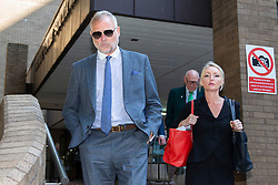 © Licensed to London News Pictures. 22/08/2019. London, UK. John Leslie (l) departs Southwark Crown Court. The former BBC Blue Peter presenter is expected to enter a plea in connection with a charge of sexual assault dating from 2008. Photo credit: George Cracknell Wright/LNP
