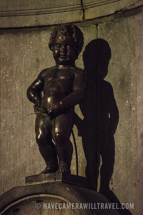 The Mannekin Pis, a small bronze fountain sculpture of a naked little boy urinating into the fountain. Installed in about 1619 by Hiëronymus Duquesnoy the Elder, it is a cultural symbol of the city of Brussels and a famous tourism landmark. Please note that this image includes some high iso image noise.