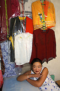 GOBI DESERT, MONGOLIA..08/31/2001.Bayangovi. Young lady owning a textile shop..(Photo by Heimo Aga).
