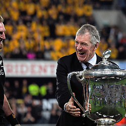 NZ Rugby president Maurice Trapp prepares to present the Bledisloe Cup to All blacks captain Kieran Read after during the Rugby Championship and Bledisloe Cup rugby match between the New Zealand All Blacks and Australia Wallabies at Forsyth Barr Stadium in Dunedin, New Zealand on Saturday, 26 August 2017. Photo: Dave Lintott / lintottphoto.co.nz