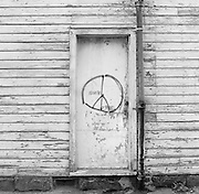 A peace sign painted on a door in Ohio City, Cleveland, Ohio.