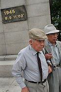 Akira Iwanaga (on right) and Tsutomu Yamaguchi (on left), pay their respects at the memorial stone marking the epicentre of the Nagasaki Atomic bombing blast on 9th August 1945, in Nagasaki, Japan,  Tuesday May 24th 2005. Both men were in Hiroshima on the day of the first atomic bombing, 6th Aug. 1945, and also in Nagasaki three days later on the day of the second atomic bombing of Japan by US Military.