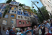 A tour group visiting the Hundertwasserhaus, the first and most famous public housing project by Austrian artist and architekt Friedensreich Hundertwasser.