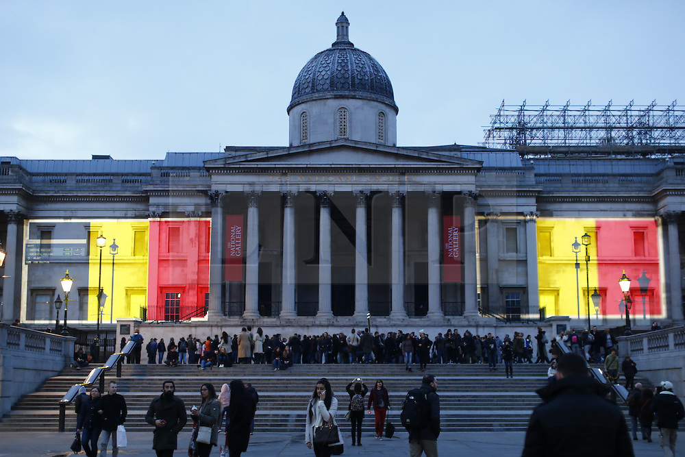 © Licensed to London News Pictures. 23/03/2016. London, UK. A projection of the Belgian flag is beamed onto the National Gallery in London to pay tribute to Brussels terror victims on Wednesday, 23 March 2016. Photo credit: Tolga Akmen/LNP