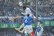 Coventry City Forward, Amadou Bakayoko (21) beats Portsmouth Defender, Christian Burgess (6) in the air during the EFL Sky Bet League 1 match between Portsmouth and Coventry City at Fratton Park, Portsmouth, England on 22 April 2019.