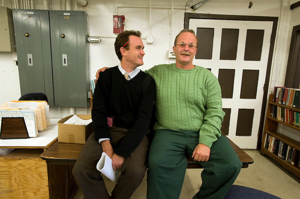 "Max Kenner (left) with inmate and Bard College graduate Bill Doane (55) in the computer room at Woodbourne Correctional Facility. Max is the brainchild behind the privately funded Bard College  Initiative for prison inmates. Bill, who graduated from Bard in 2008, was sentenced to 24 years in prison...Story: The Bard Prison Initiative.Former inmate Carlos Rosario, 35-year-old husband and father of four, was released from Woodbourne Correctional Facility after serving more than 12 years for armed robbery. Rosado is one of the students participating in the Bard Prison Initiative, a privately-funded program that offers inmates at five New York State prisons the opportunity to work toward a college degree from Bard College. The program, which is the brainchild of alumnus Max Kenner, is competitive, accepting only 15 new students at each facility every other year. .Carlos Rosario received the Bachelor of Arts degree in social studies from the prestigious College Saturday, just a few days after his release. He had been working on it for the last six years. His senior thesis was titled ""The Diet of Punishment: Prison Food and Penal Practice in the Post-Rehabilitative Era,"".Rosado is credited with developing a garden in one of the few green spaces inside the otherwise cement-heavy prison. In the two years since the garden's foundation, it has provided some of the only access the prison's 800 inmates have to fresh vegetables and fruit...Rosario now works for a recycling company in Poughkeepsie, N.Y...Photo © Stefan Falke"